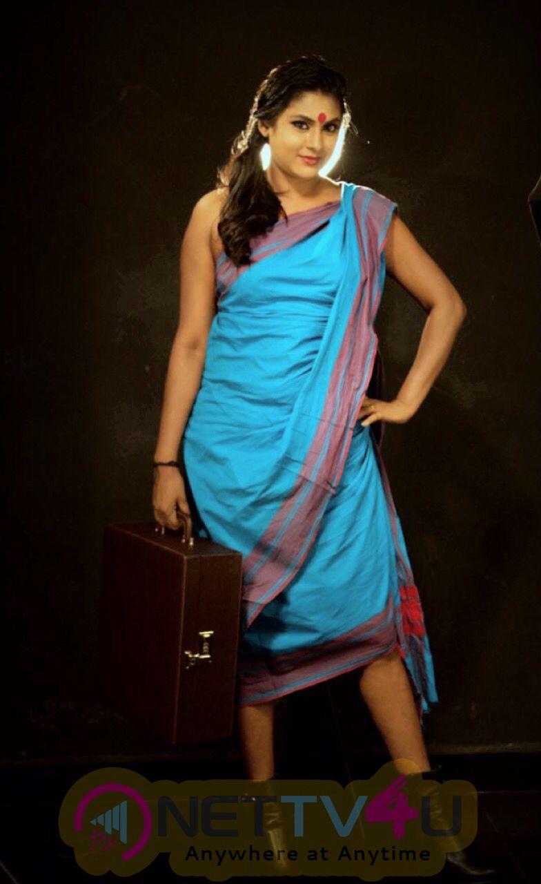 Actress Puvisha Lovely Stills Tamil Gallery