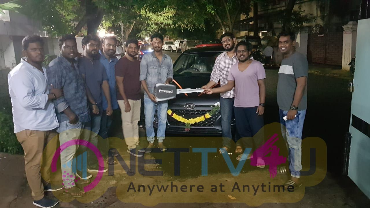 Pyaar Prema Kadhal Movie Producers Car Gifts To Director Elan Images