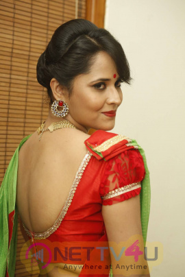 Anchor Anasuya Images In Green Saree At Cinema Chupista Mama Audio Launch