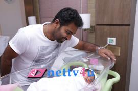 shobi paul raj is blissful with new born baby girl photos