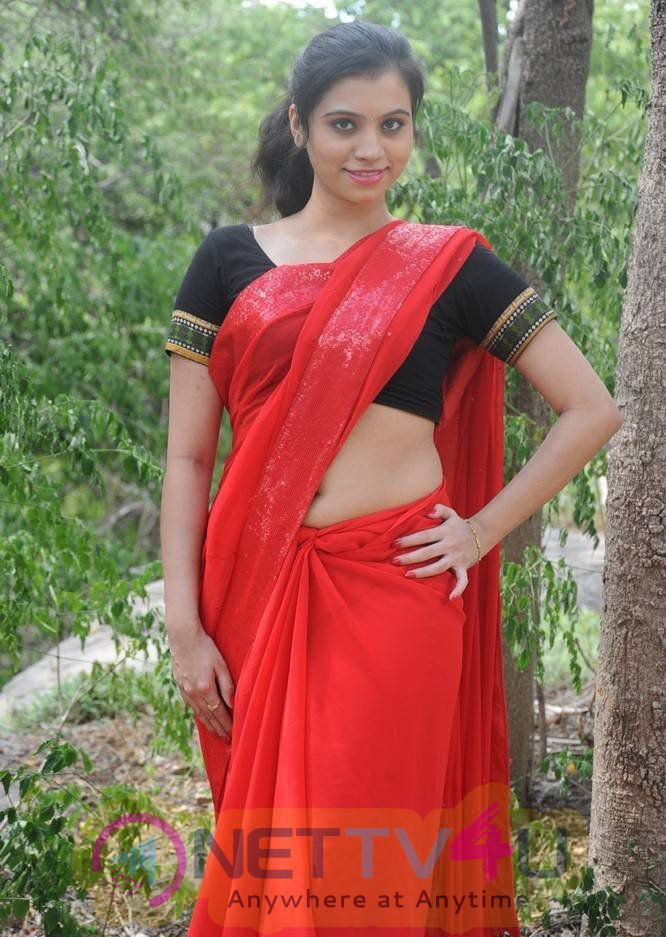 Actress Priyanka Deep Navel Show In Red Saree Stills
