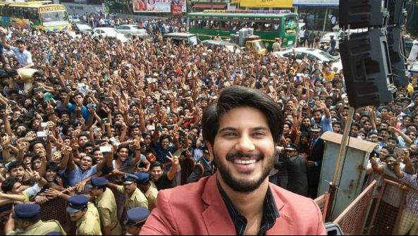 Dulquer's Selfie With His Crazy Fans In Calicut!